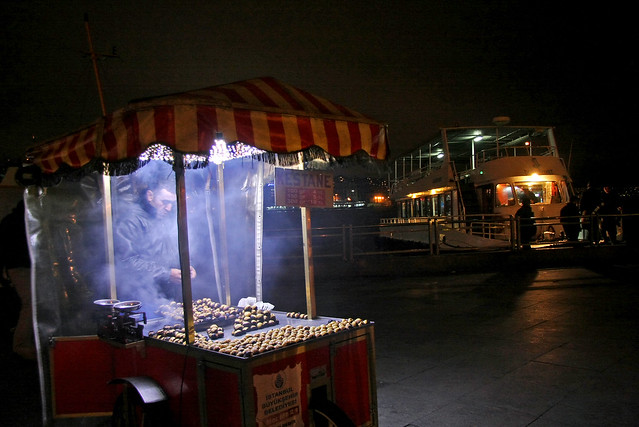 Roast chestnuts stand and ferryboat in Eminonu, Istanbul, Turkey イスタンブール、エミノニュのフェリーと焼き栗屋台
