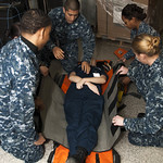 Sailors practice using a stretcher.