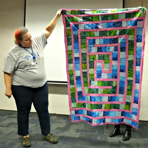 Kenzie with a quilt for her mom