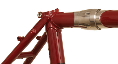 <p>Seat cluster area on this Waterford randonneuring design includes several notable features:  S&S couplers, tulip seatstay plugs, radial rear fender boss placement and barrel-style rear rack mounts.  Styled in Garnet Matellic.  63115</p>