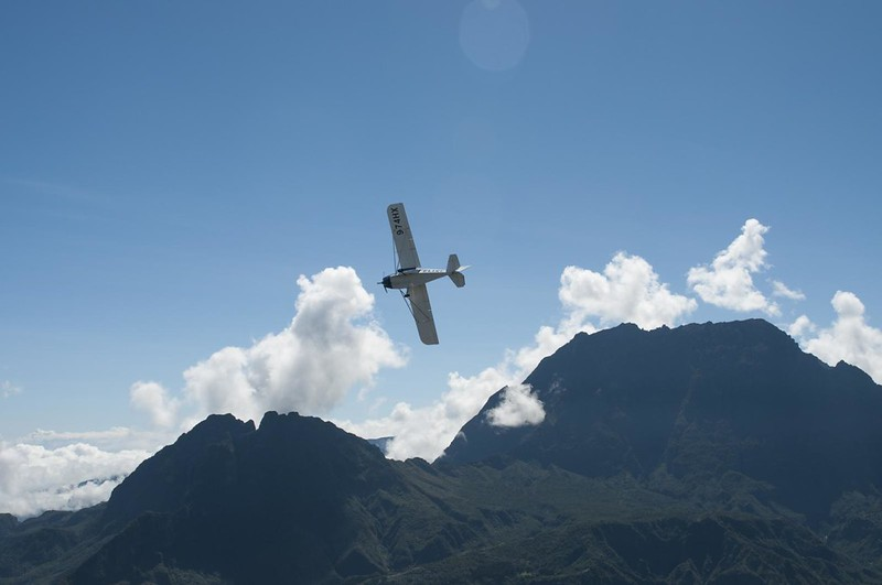 Ultralight plane over Mafate