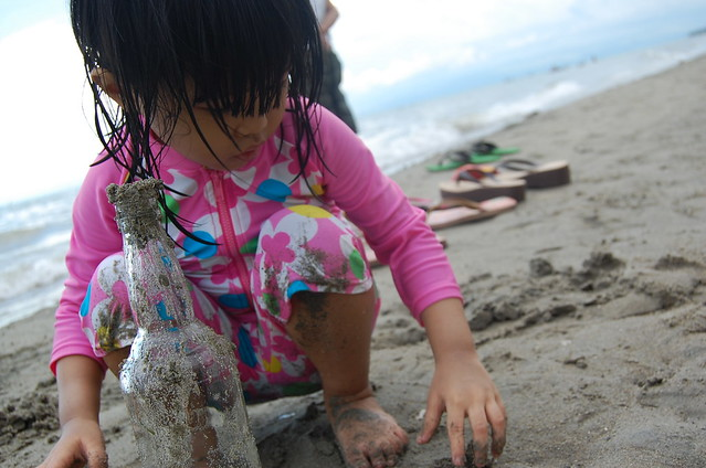 playing with the sand and bottle