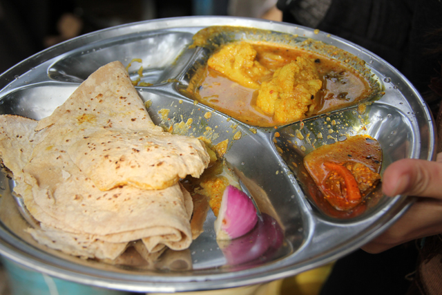 Kolkata street food the ultimate hungry guide indian street food aloo gobi vegetable curry and fresh chapatis forumfinder Image collections