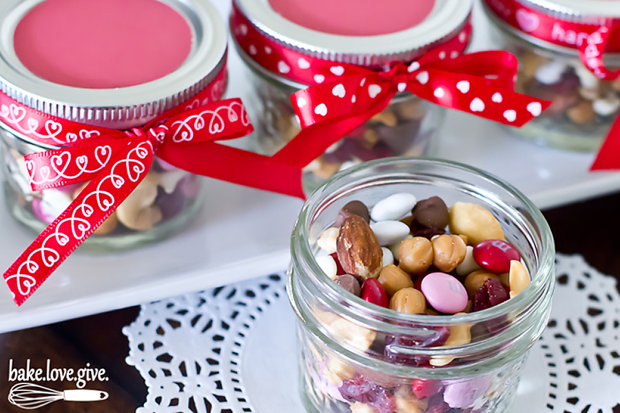 Small mason jars filled with festive trail mix are a uniquely sweet way to spread love this Valentine's Day.