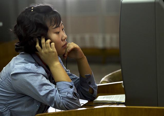 North Korean Woman Watching Dvd At The Grand People Study House, Pyongyang, North Korea