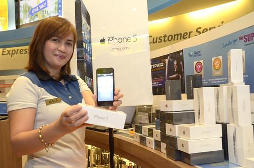Karen Eudela, Asst. Retail Manager shows off the iPhone 5