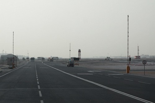 Aircraft level crossing on the eastern side of the Doha International Airport perimeter road