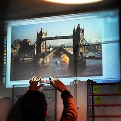 Giant rubber-duck goes under tower bridge. Projected on the @lanyrd wall