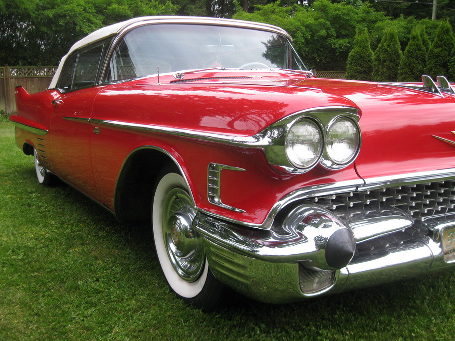 A red 1958 Cadillac Coupe converted to a Convertible ...