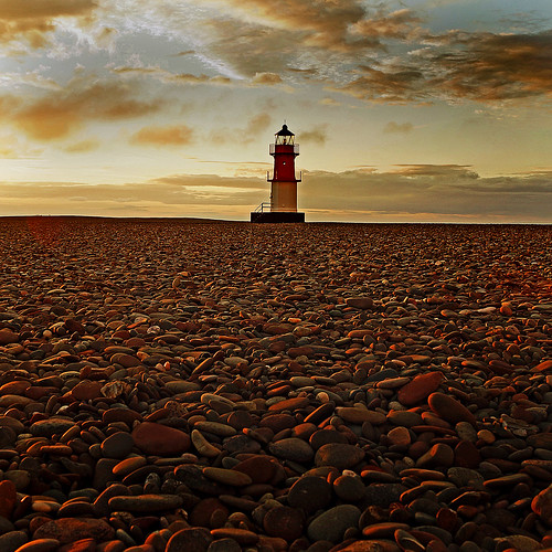 sunset lighthouse beach sony pebbles alpha isleofman a77 pointofayre