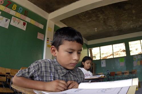 HONDURAS: Child Reads at Desk