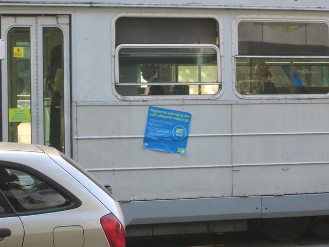 Myki sticker (taken off a Metcard machine, it appears) on side of tram