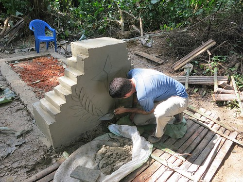 Roger works on the tomb