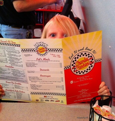 Checking out the menu at Charlie Parker's Diner