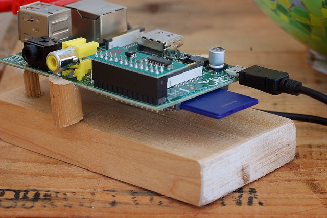 A Raspberry Pi mounted on a piece of wood