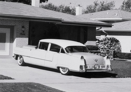 A classic American 1950's era car in the driveway.  Oak Lawn Illinois.  October 1990. by Eddie from Chicago