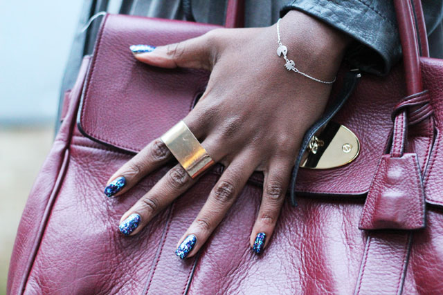 Models Own Freak out glitter nail polish with pac man bracelet