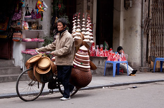 Conical Hat & Basket Vendor in The Old Quarter - Hanoi, Vietnam