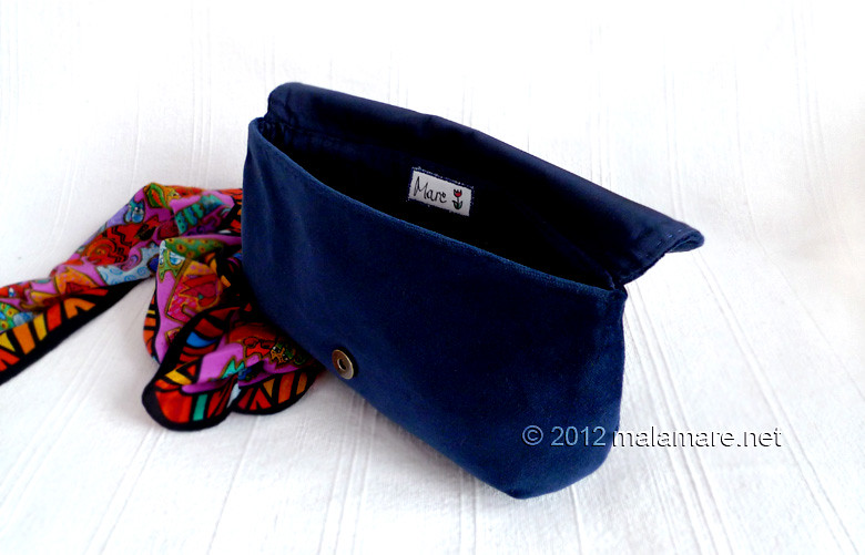 Blue velvet evening clutch bag inside
