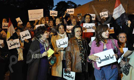 Dozens of Egyptian women demonstrating against the draft constitution on the way to being adopted by the voters inside the country. Many have rejected the vote surrounding the referendum. by Pan-African News Wire File Photos