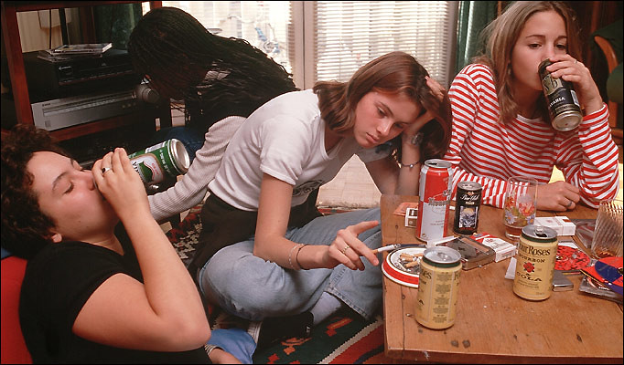 four women drinking beer and looking depressed
