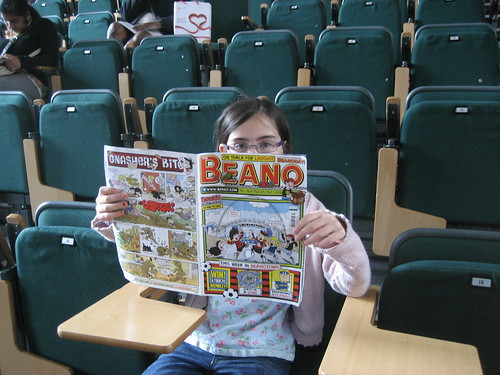 Livvy reading her Beano in the lecture theatre at City University