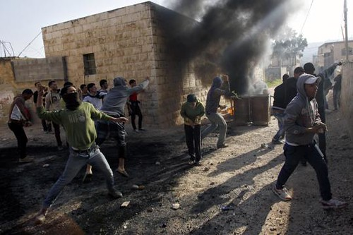 Palestininans clash with Israeli security forces on January 1, 2013. The Israelis had detained a Palestinian sparking the unrest. by Pan-African News Wire File Photos