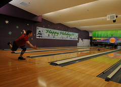 Fire Controlman 2nd Class Anthony Ingrassia bowls during a tournament organized by the USS George Washington branch of CSADD, Dec. 15. (US Navy photo by Mass Communication Specialist Seaman Justin Yarborough)