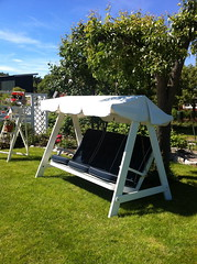 outdoor structure(0.0), outdoor play equipment(0.0), canopy(0.0), play(0.0), gazebo(0.0), tent(0.0), backyard(1.0), swing(1.0),