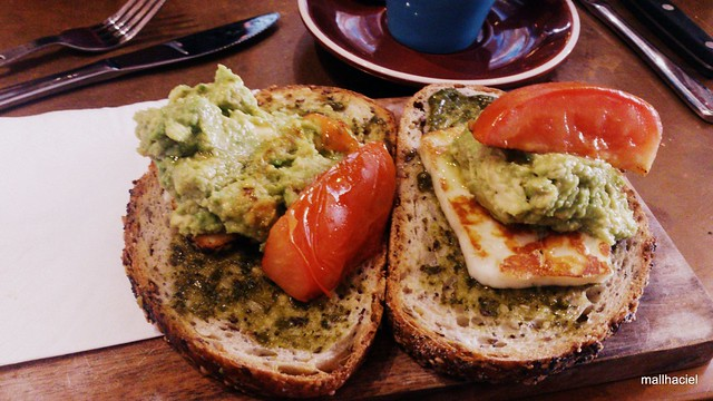 Crushed avocado, tomato, haloumi and pesto on sourdough