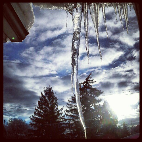 Came out of my job to see this hanging over the front door #ice #icicles #icicle #sky #clouds #instagood #blue #winter #snow #erie #eriepa #weather #eriegram