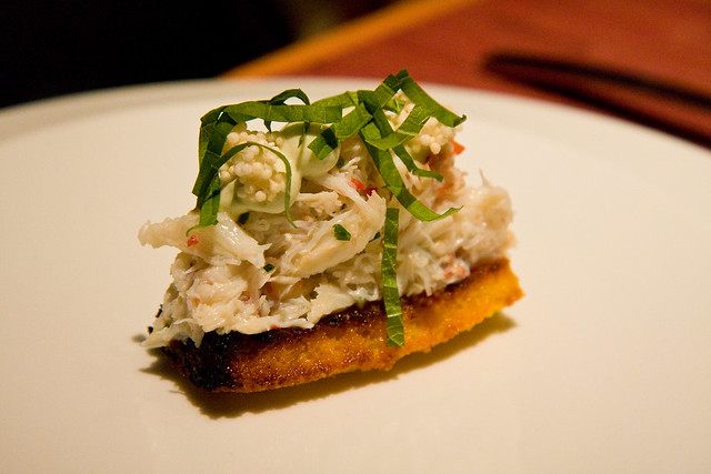 Crab toast with saffron, kaffir yogurt, and arare, wd-50