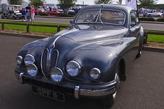 automobile, automotive exterior, vehicle, automotive design, jaguar mark 1, antique car, sedan, vintage car, land vehicle, luxury vehicle,