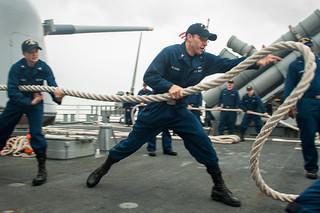 Sailors moor USS Mobile Bay in Bahrain.