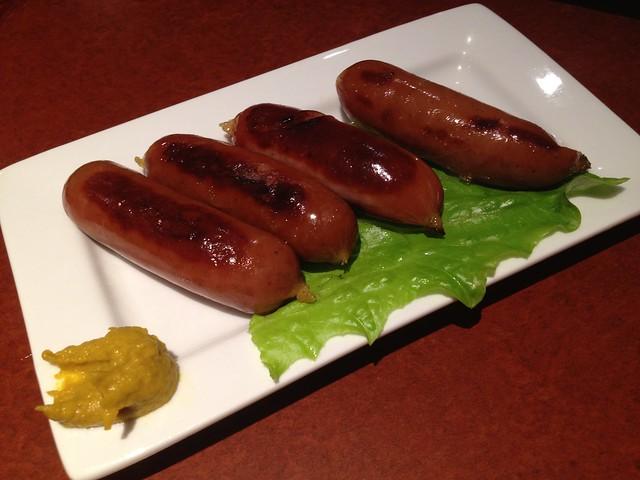 Kurobuta sausage teppan yaki - Izakaya Takonoki