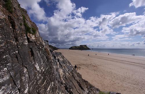 uk blue sea sky people cliff cloud holiday beach sunshine stone wales landscape coast sand view rocky scene pembrokeshire tenby seaview