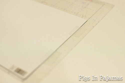 Taping the paper to the cutting mat