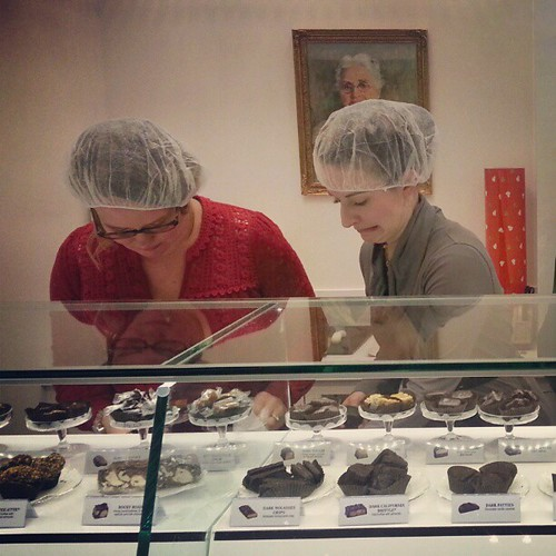 Emily and Casey pack chocolate Lucy style as Mary See looks on. (Probably in horror.)