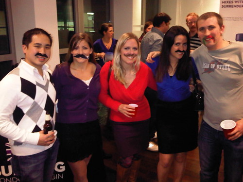 "Movember enthusiasts celebrate ""Embassy Mo's on Embassy Row"" festivities. L to R: Americans Alex Nguyen, Attie Poirier, Holly Norman, Kate Norman share a toast with Richard Lindley, an embassy employee from Bedfordshire, England."