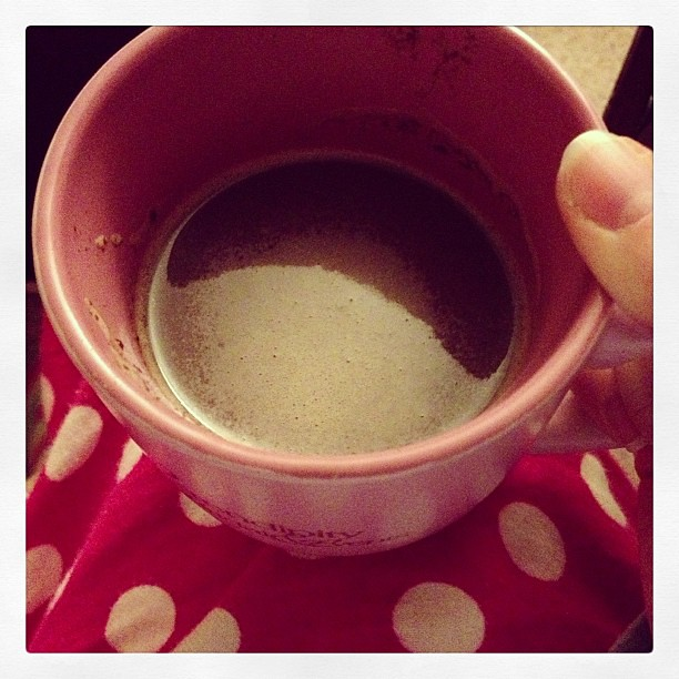 Enjoying delicious hot chocolate made by Collin while lounging in my PJs.