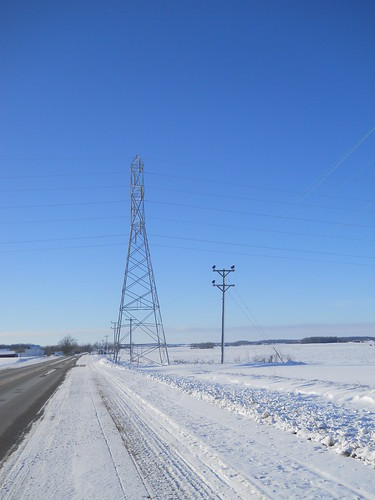 Power tower next to the road