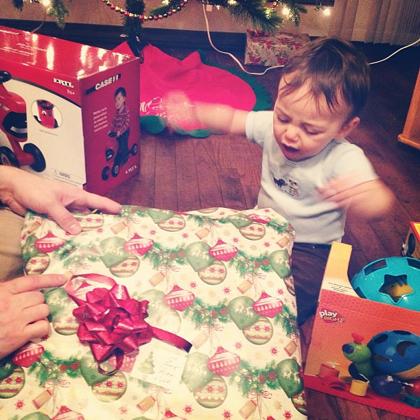 Paper-ripping baby loves Christmas