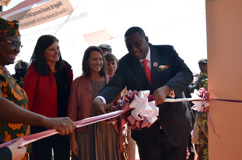 The Honorable Vice President of Malawi, Khumbo Kachali (right), cuts a ribbon during the opening ceremony Nov. 30 for the Dowa Teachers Training College in Malawi with the help of the Honorable Minister of Education, Science and Technology of Malawi, Eunice Kazembe (far left), as Marie Lichtenberg (second from left), Director of International Partnerships at Humana People to People/Planet Aid, and Kate Snipes, FAS Agricultural Counselor at the U.S. Embassy in Kenya, watch. (Courtesy Photo)