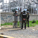 Military police stand guard outside an Electric Substation in La Paz, Bolivia