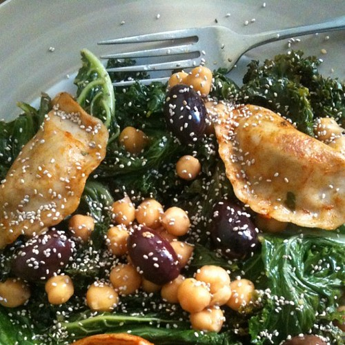 Sunday lunch #vegan salad: pretty, nutritious and delicious. Kale, olives, chia seeds, garlic, chick peas & vegan dumplings. #bodylove #selfcare #yummy