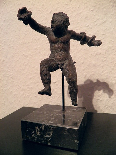 Baby Hercules wrestling with the snakes Hera has sent to his crib, replica of bronze statuette exhibited at the Musée de Metz (France), 2nd - 3rd century AD