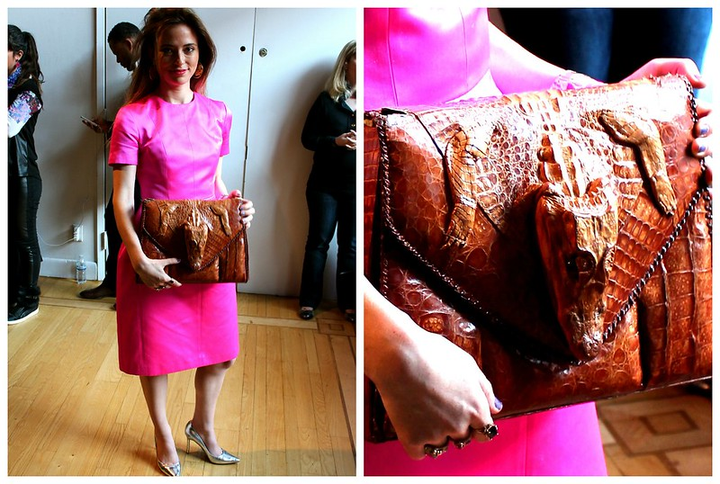 fluorescent pink dress and crocodile clutch