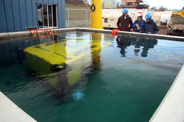 Ocean Networks Canada's spare node on the bottom of the test tank. Jonathan Zand, Martin Hofmann and Jonathan Miller.