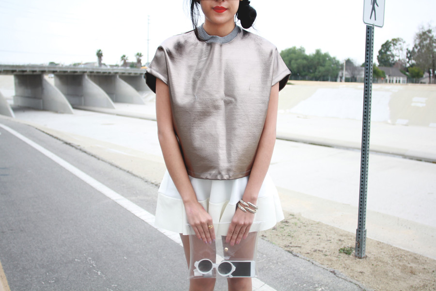Neil Barrett Metallic Boxy Blouse, white neoprene skirt, Clarity Transparent Clutch at shoptarte.com, White jelly heels shoes, Tarte Vintage
