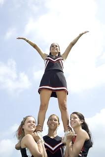 Cheerleaders Doing Routine --- Image by © Royalty-Free/Corbis